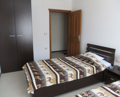 o sengs soveværelse i ferielejlighed